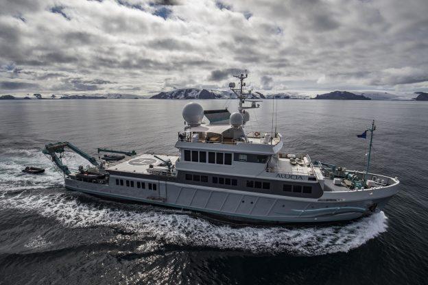 Yacht Alucia cruising in Antarctica