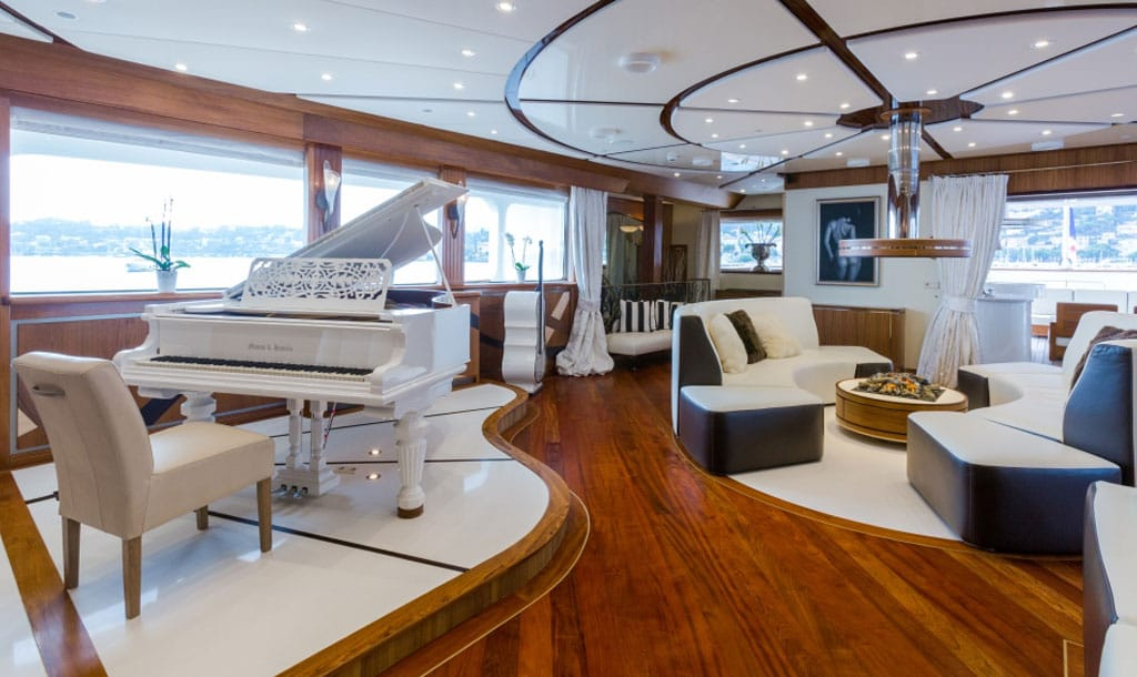 EYOS Expedition Legend Yacht piano and fireplace