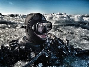 Kelvin Murray diving in the ice
