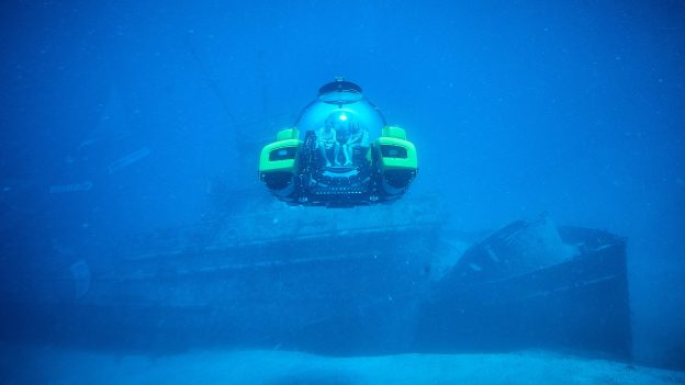 Triton Submarines diving near shipwreck