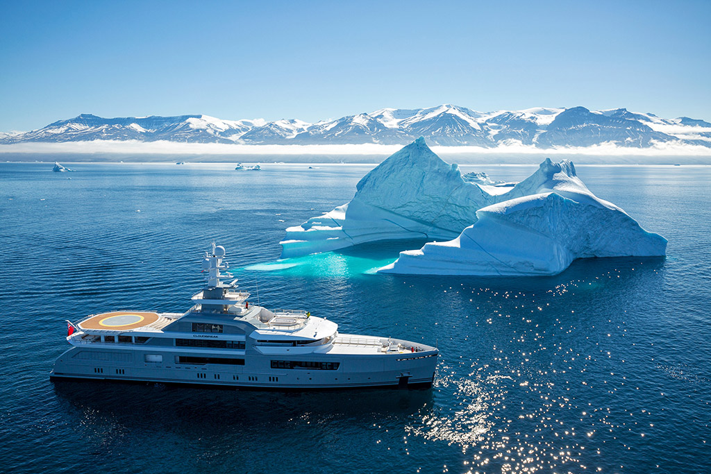Cloudbreak expedition yacht next to iceberg